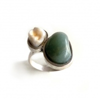 Silver ring with a stone and a molar