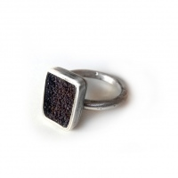 Silver ring with poppy seed